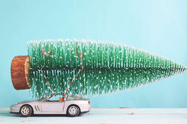 Christmas Sports Car.Christmas Tree On Sport Car Toy Matt Color Filter Photo