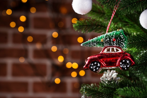 Christmas tree toy in shape of red car Premium Photo