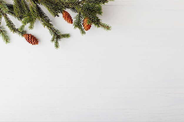 Christmas tree on a white wooden table preparation for writing the text, . Premium Photo