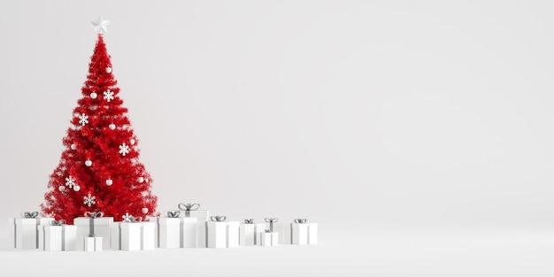 Рождественская елка зимнее украшение с подарочными коробками на белом фоне Premium Фотографии