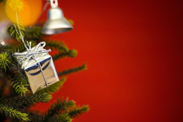 Christmas tree with a bell and a gift Free Photo