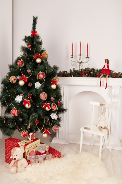 Christmas tree with a doll Free Photo