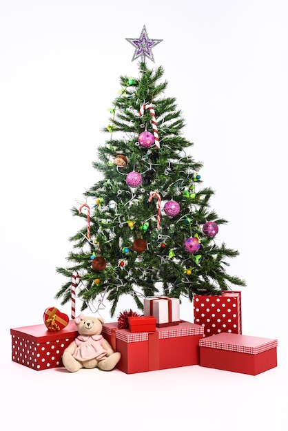 Christmas tree with gifts on white background Free Photo