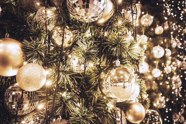 Christmas Tree With Gold Ball And Bokeh Lights Background Photo