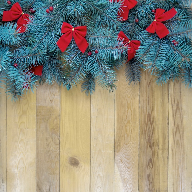 Christmas tree with red decoration on wooden Premium Photo