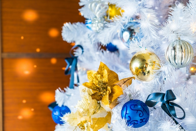 Christmas tree with white branches, golden stars and blue balls Free Photo