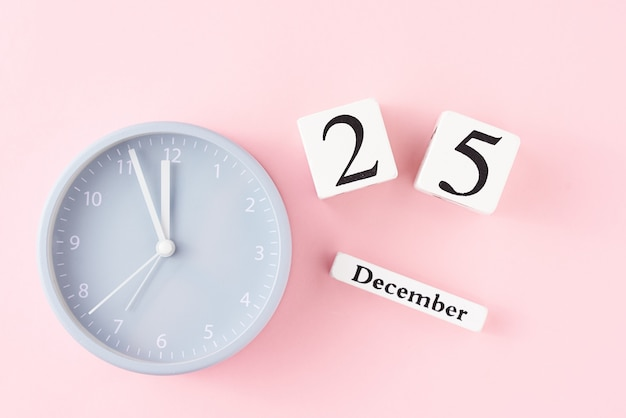 Christmas  with alarm clock on pink Premium Photo