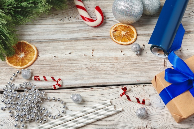 Christmas wrapping and decorating items on wooden background with copy space Premium Photo