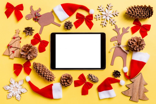 Christmas yellow with holiday toys and decorations. Premium Photo