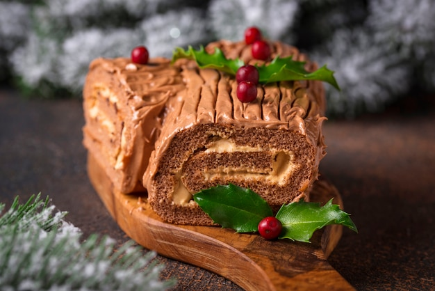 Christmas yule log cake. traditional chocolate dessert Premium Photo