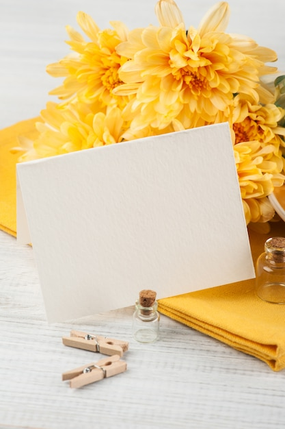 Chrysanthemum flowers on a wooden table, blank paper Premium Photo