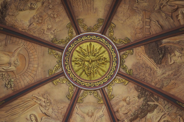Church dome interior gold painted dove with paintings all around Free Photo