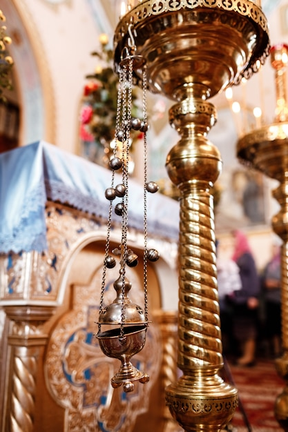Church incense. censer hung in the church. incense during mass at the altar Premium Photo