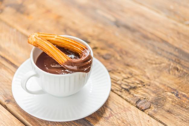 Churros with chocolat typical  sweet spanish Premium Photo