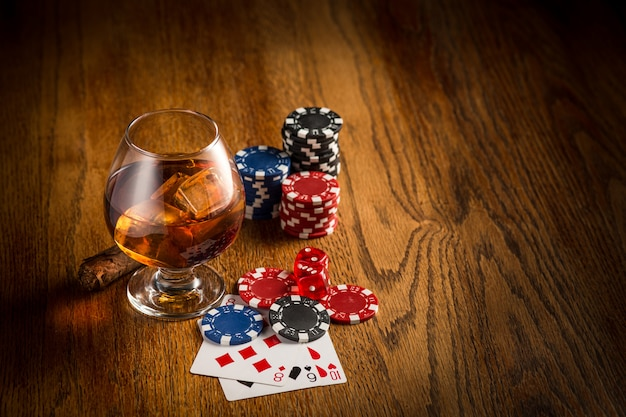 Cigar, chips for gamblings, drink and playing cards Free Photo