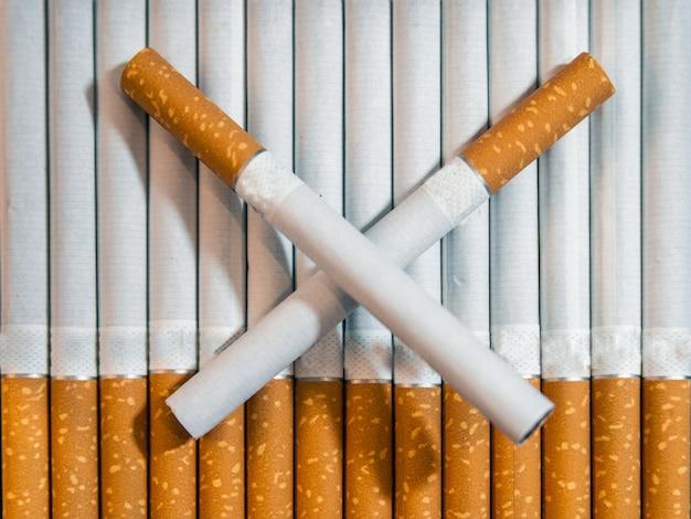 cigarette close up isolated on white background. Drug addiction. Tobacco smoking. cancer. Nicotine. Bad habit.  Ashtray. quit Smoking Free Photo