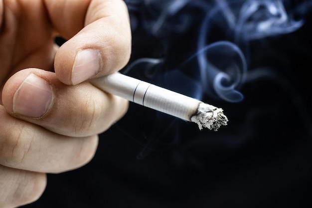 Cigarette hand black Premium Photo