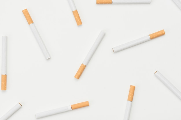 Cigarettes pattern over isolated on white background Free Photo