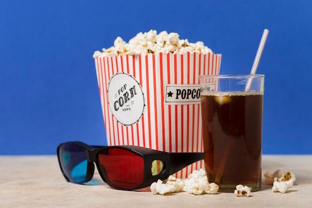 Cinema glasses with popcorn and juice Free Photo