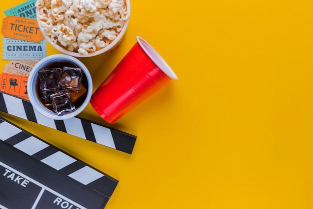 Cinema menu with clapperboard Free Photo