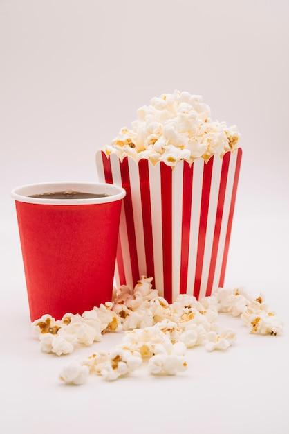 Cinema popcorn box with a soft drink Free Photo