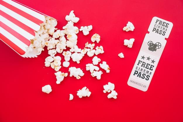 Cinema popcorn box with a ticket Free Photo