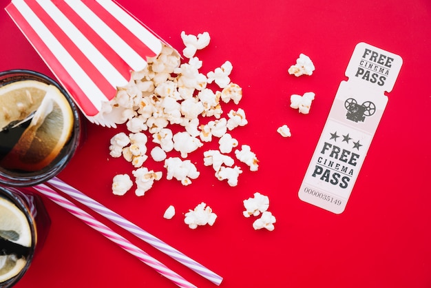 Cinema popcorn box with a ticket Free Photo
