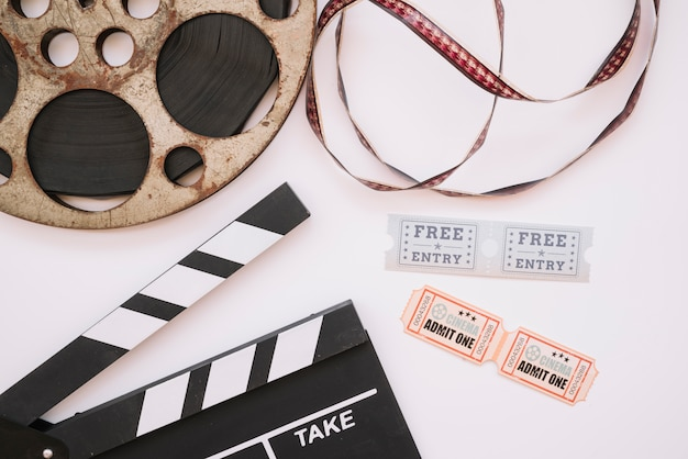 Cinema reel with clapperboard Free Photo