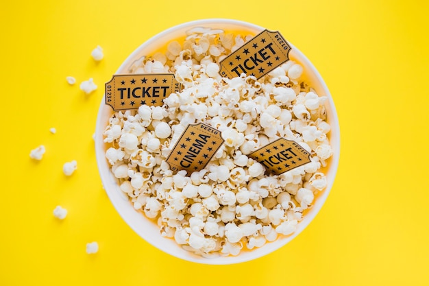 Cinema tickets in bucket with popcorn Free Photo