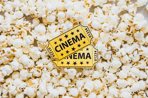 Cinema tickets on crispy popcorn Free Photo