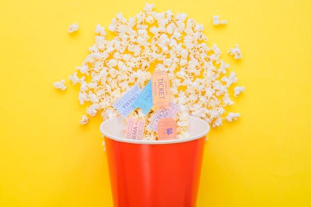 Cinema tickets in popcorn bucket Free Photo