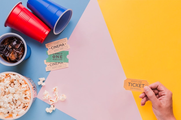Cinema tickets with popcorns and drinks Free Photo