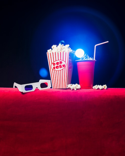 Cinema with popcorn box and 3d glasses Free Photo