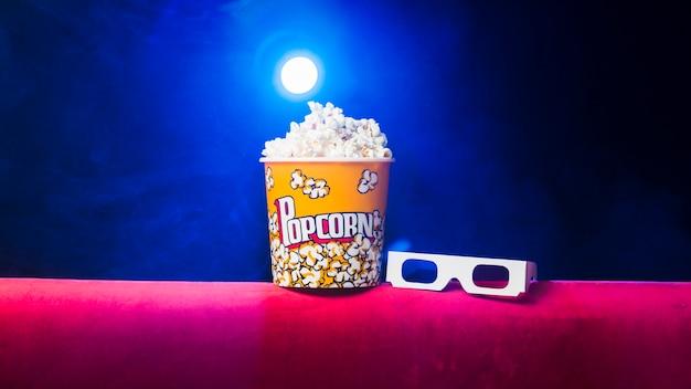 Cinema with popcorn box Free Photo