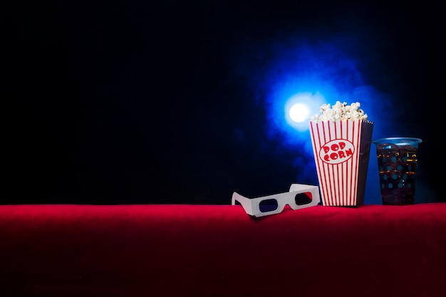 Cinema with popcorn box Free Photo