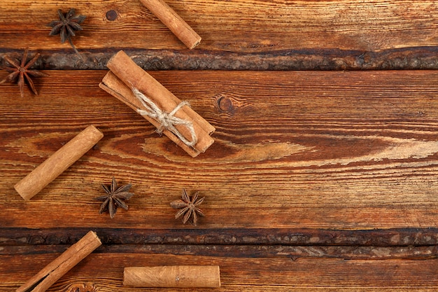 Cinnamon on dark wooden background with space for text Premium Photo