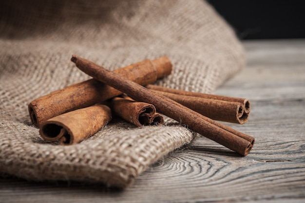 Cinnamon sticks on wooden background Premium Photo