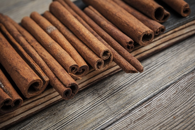 Cinnamon sticks on wooden. Premium Photo