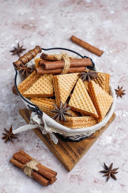 Cinnamon waffles on grey concrete table Free Photo