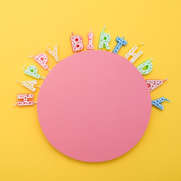 Circle of unlit birthday candles with letters Free Photo