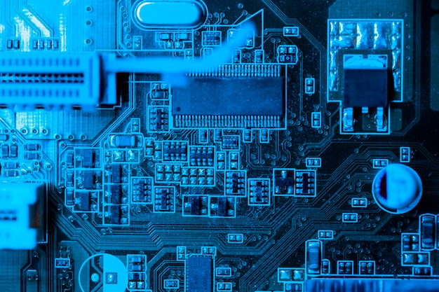 Circuit board in blue theme with slot Premium Photo