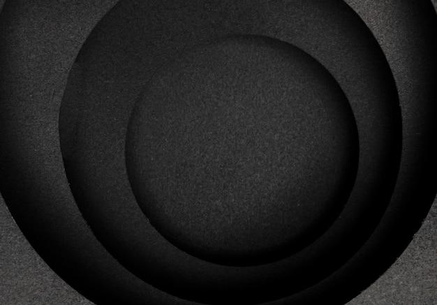 暗い背景の円形のレイヤー 無料写真