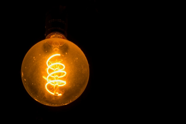 Circular light bulbs that see electric coils used in energy design and special ideas Premium Photo