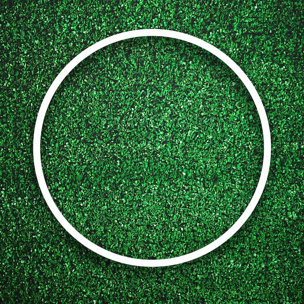 Circular white frame edge on green grass with shadow background. decoration background element concept Premium Photo