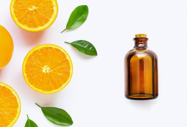Citrus essential oil with fresh orange fruit isolated on white Premium Photo