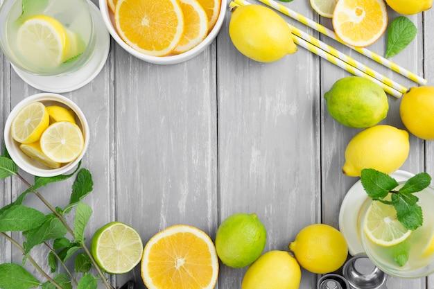 Citrus frame with straws Free Photo