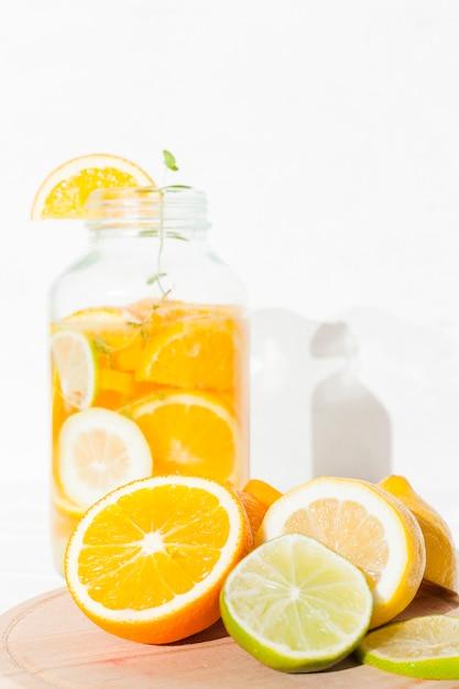 Citrus fruit and lemonade in bank Free Photo
