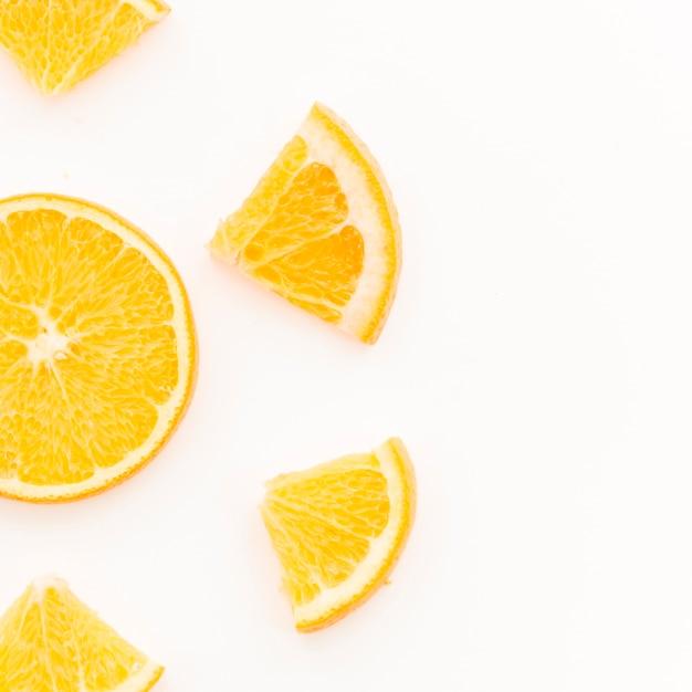 Citrus fruit slices on white background Free Photo