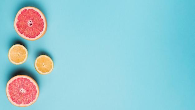 Citrus fruits on blue background Free Photo