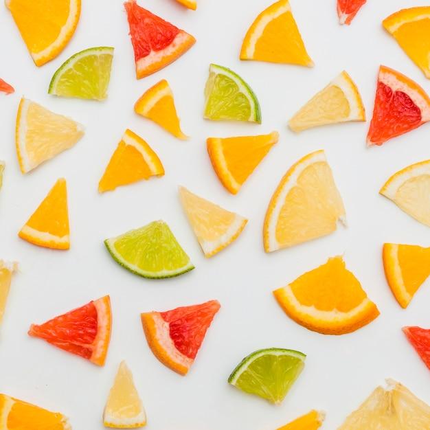 Citrus fruits slices isolated on white background Free Photo